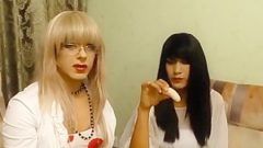 Crossdressers playing with bananas