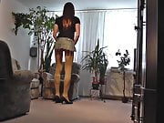Crossdresser in miniskirt , pantyhose and High Heels T-Girl